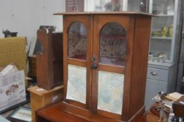 A shop's table top pine twin glazed arched panel door cabinet with shelved interior, on a plinth