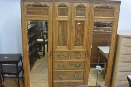 A Victorian ash and walnut inlaid three part wardrobe, the cornice with later adjusted moulded front