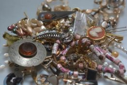 A large collection of costume jewellery inc. white metal, paste earrings, dress rings, brooches, tie
