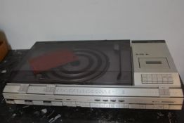 A Bang & Olufsen Beocenter 4600 complete with turntable, cassette player and radio, in original teak