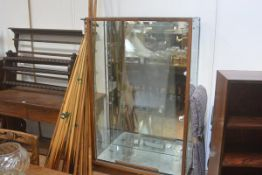 A 1950's oak-framed twin sliding glazed door and shelved, mirror-backed display cabinet. 151cm by