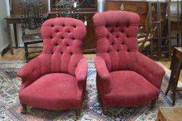 A pair of lady's and gent's 19th century walnut framed drawing room chairs, with upholstered