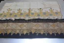 An Edwardian hand embroidered silk work panel on linen, with stylised cornflower and leaf embroidery