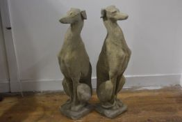 A pair of composition stone models of seated greyhounds, each on moulded square base. 74cm