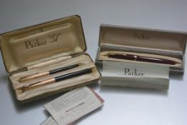 A Parker 51 propelling pencil and fountain pen set with box and papers; tog. with a Parker 61