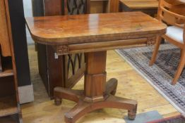 A 19th century faded mahogany foldover D-end tea table, on ocatagonal column and bipod supports ( in