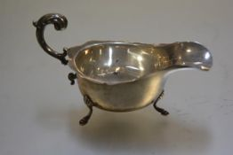 A Chester silver George III style sauceboat with scalloped border and C scroll handle to side,