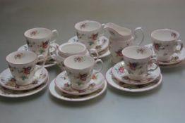A Royal Stafford china twenty piece teaset comprising six teacups, saucers and side plates, milk jug