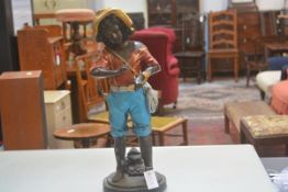 A cast bronze figure, Huckleberry Finn with Cat Fish, on circular moulded base, decorated with
