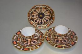 A Royal Crown Derby Imari pattern no.21 octagonal coffee can, saucer and side plate and an octagonal