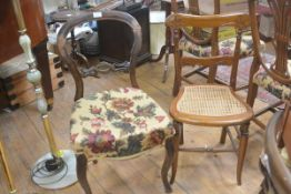A Victorian walnut arched back side chair with stuffover seat, raised on carved moulded supports and