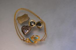An Edwardian yellow metal heart locket set two garnets and an oval opal cabouchon (l. 2cm), a yellow