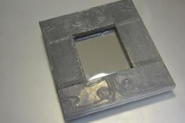 A modern Arts & Crafts style pewter embossed rectangular mirror by David S Brown, paper label