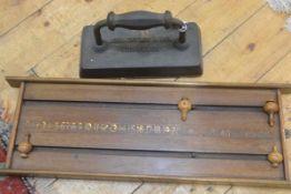 A cast iron John Taylor & Sons, Edinburgh snooker table flat iron and a John Taylor, Edinburgh