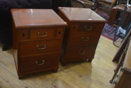A pair of Eastern hardwood bedside/ lamp tables, the square tops with moulded edge above an