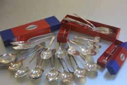 A collection of miscellaneous community plate including table spoons, serving spoons, pickle fork,