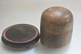 A hatmaker's treen sectional oval mould (h.19cm x 17cm x 16cm) and a treen ebonised dome stand (d.