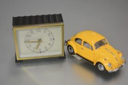 A Franklin Mint 1967 Volkswagen Beetle yellow model car and and a Glen 1950s Scottish made plastic