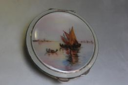 A Birmingham silver enamelled compact, the centre panel with view of Gondolas and Fishing Boats with