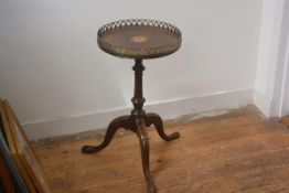 An inlaid mahogany tripod table with brass gallery on associated base. 56cm by 33cm