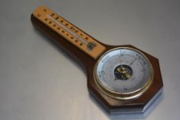 An S.B. compensated mahogany wall mounted barometer, complete with thermometer (l.31cm x 13cm)