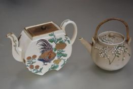 A Japanese porcelain teapot with shagreen style finish and stylised bamboo design and bamboo