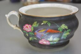 A 19thc English china chamber pot with handpainted transfer printed design of exotic bird and