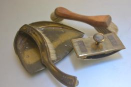 An Aesthetic brass mounted crumb scoop and brush, a brass desk ink blotter and a scouring brush (3)