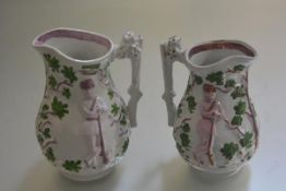 A pair of 19thc moulded lustre jugs decorated with huntsman (h. 21cm and 23cm)