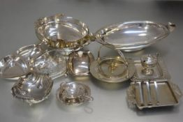 An Epns tea strainer, a collection of plated butter dishes, an Epns condiment set, an hors d'oeuvres