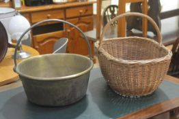 A 19thc brass preserve pan with cast iron loop handle to top (h. 14cm d.32cm) and an Edwardian