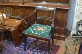 A Regency mahogany framed carver chair with curved top rail and ball pattern spar back, with slip in