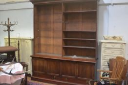 A 19thc mahogany two part upright open bookcase, the moulded cornice above an arrangement of