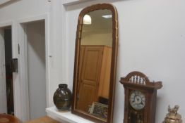 A reproduction gilt-composition and painted scalloped frame Queen Anne style wall mirror. 111cm by