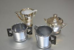 A Swan brand Mayfair chrome plated vintage 1950s sugar basin and cream ewer, and a Continental
