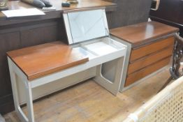A modern Schreiber teak and laminated two piece bedroom suite comprising a dressing table with