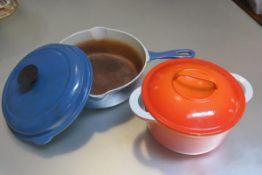 A Le Cruset blue enamelled cast iron saucepan and a Casran cast iron orange enamelled casserole dish