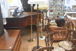 A stained ash turned wood floor lamp and shade raised on circular moulded base with Deco style
