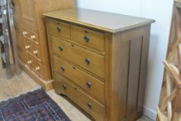 An Edwardian oak chest, with two short and three long drawers, on fluted side supports with original