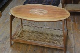 A mahogany boxwood strung oval occasional table, with canework undertier, on splayed supports.