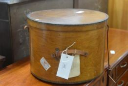 A 19thc bentwood circular hat box with leather strap and handle to side (h.30cm x d.41cm)
