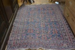 A Caucasian rug, the centre panel with three rows of stylised diamond design, enclosed within a