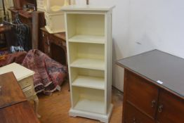 A white finish painted upright open bookcase with three adjustable shelves. 118cm by 45cm by 26cm