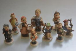 A collection of nine various Hummel pottery figures including Chimney Sweep Boy, the Little