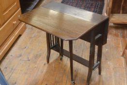 An Edwardian mahogany Sutherland table of characteristic form, with cut corners and slatted end
