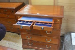 An Eastern hardwood chest, the rectangular top with moulded edge above a pull out leather slide,