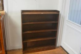 A 1920's upright open bookcase with ledge back and fitted with five shelves. 108cm by 91.5cm by