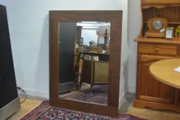 A walnut rectangular framed overmantle with bevelled glass plate (122cm x 92cm)