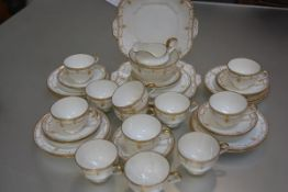 A Collingwood 1920s/30s forty piece yellow and gold enamelled Adam style tea service with