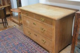 An Edwardian oak chest, the rectangular top (a/f) over 2 short and 2 long drawers, on square